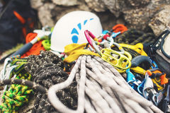 Used Climbing Equipment - Carabiner Without Scratches, Climbing Hammer, White Helmet And Grey,red,green And Black Rope Royalty Free Stock Photos