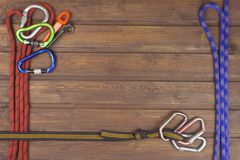 Used climbing gear on wooden background. Advertising boards of trade. The concept of extreme sports. Royalty Free Stock Photography