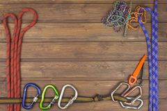 Used climbing gear on wooden background. Advertising boards of trade. The concept of extreme sports. Stock Images