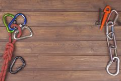Used climbing gear on wooden background. Advertising boards of trade. The concept of extreme sports. Royalty Free Stock Photos