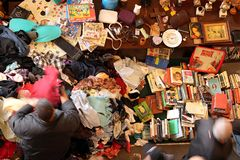 Used clothes and books at the Mercat Dell Encants in Barcelona stock photo