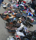 used clothes and shabby clothing in an outdoor flea market stock photo