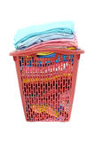 Used cloths in old red plastic basket Royalty Free Stock Photos