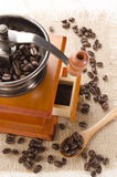 Used coffee grinder and beans Stock Photo