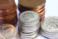 Used UK Coins. A stacked of UK five pence pieces surrounded by stacks of other coins Royalty Free Stock Photography