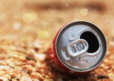 Used cola can top opened with background bokeh Royalty Free Stock Photo
