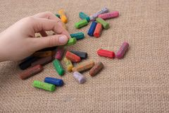 Used  color crayons and a teenagers hand. Used  color crayons and a hand holding one Royalty Free Stock Images
