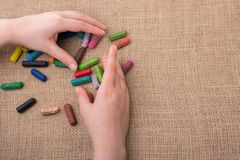 Used  color crayons and a teenagers hand. Used  color crayons and a hand holding some Royalty Free Stock Image