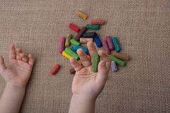 Used  color crayons and a toddlers hand. Holding one Royalty Free Stock Photos