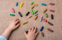 Used  color crayons and a toddlers hand. Holding one Royalty Free Stock Photo
