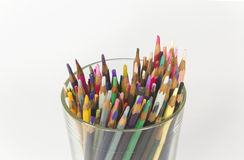 Used color pencils in a glass. On white background Royalty Free Stock Images