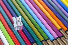 Used color pencils and sharpener Royalty Free Stock Images