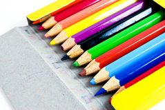 Used color pencils in yellow box Royalty Free Stock Photography