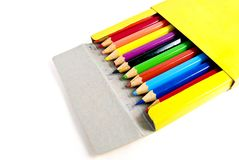 Used color pencils in yellow box isolated Royalty Free Stock Image