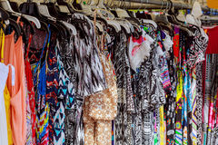 Used colored An elderly female garments for sale on the market. Used colored female sweaters on rack for reselling,recycling,donating,reusing or thrift store for Royalty Free Stock Photography