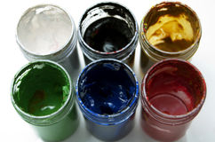 Used colorful paint buckets. Six used colorful paint buckets Royalty Free Stock Photo