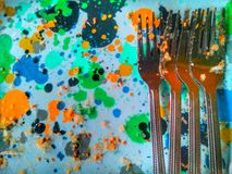 Used colorful plate and fork stock photography