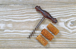 Used Corks with Vintage Corkscrew Opener Stock Photos