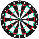 Used dart board with three arrows Stock Photos