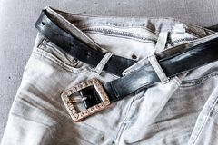 Denim jeans and a belt Royalty Free Stock Images