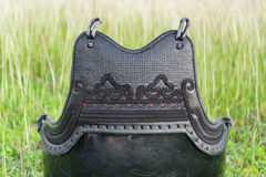 Used and Dirty Kendo Body Armour Protective or DO in grass field. Royalty Free Stock Images