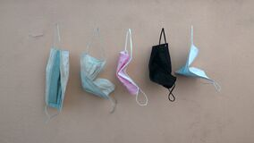 Used discarded disposable face masks
