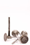 Used distorted car valves over white background Royalty Free Stock Image