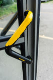 Used door handle from telephone cabin black yellow Stock Photography