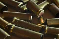 Used empty old bullet cartridges. A lot of Used empty old bullet cartridges. Dark mood of a photo royalty free stock image