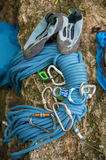 Used equipment for climbing where the rope carbines and climbing slippers lie on a rock Royalty Free Stock Photos