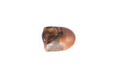 A used and flattened copper plated 9mm bullet. Stock Photography