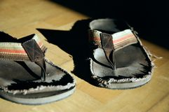 Used Flip-Flops. On parquet floor Royalty Free Stock Photography