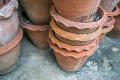 Used flower pots on the floor in warehouse Royalty Free Stock Photo