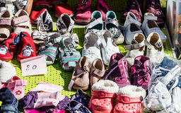 Used girl baby and child shoes for charity,reusing or reselling Stock Image