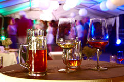Used glasses of alcohol. On party royalty free stock image