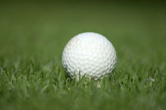 Used Golfball. Golfball, very shallow DOF with pure green on the top Stock Images