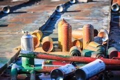 Used graffiti spray cans laying around Royalty Free Stock Photo