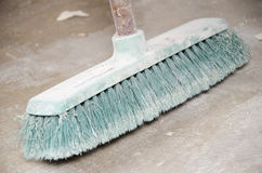 Used green broom covered with dust Royalty Free Stock Photos