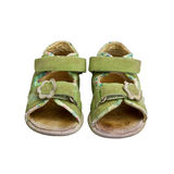 Used green child sandals isolated Stock Photo