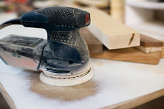 A used grinder. And some timber in a carpenter`s workshop Stock Images