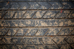 Used grunge crack car tire with brown dirt Royalty Free Stock Photo