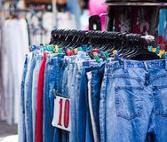 Used jean at flea market or thrift shop Royalty Free Stock Images