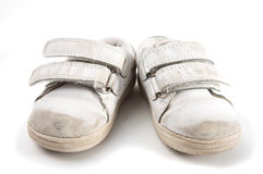 Used kid trainers. A pair of used kid trainers isolated on white Royalty Free Stock Photos