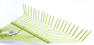 Used leaf rake on white Stock Photography