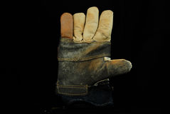 Used leather work glove black background Royalty Free Stock Photo