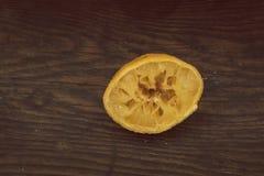 Used lemon on wood background. Vintage look Royalty Free Stock Image