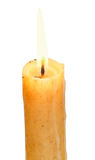 Used lighted candle close up isolated on white Stock Photography