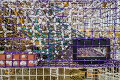 Used lobster trap closeup with barnacles and inner compartments. Interesting texture and perspective Royalty Free Stock Photos