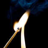 Used match and flame Stock Photography