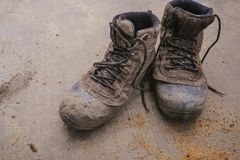 Used men`s work boots outdoors royalty free stock photo